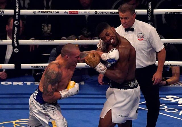 Usyk, left, staggered his opponent on several occasions (Nick Potts/PA)
