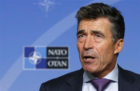 NATO Secretary General Anders Fogh Rasmussen talks to the media during a monthly news conference in Brussels