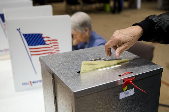 A primary election voter casts a provisional ballot at a polling place in Westerville, Ohio in March 15, 2015. (Photo: Matt Rourke/AP)