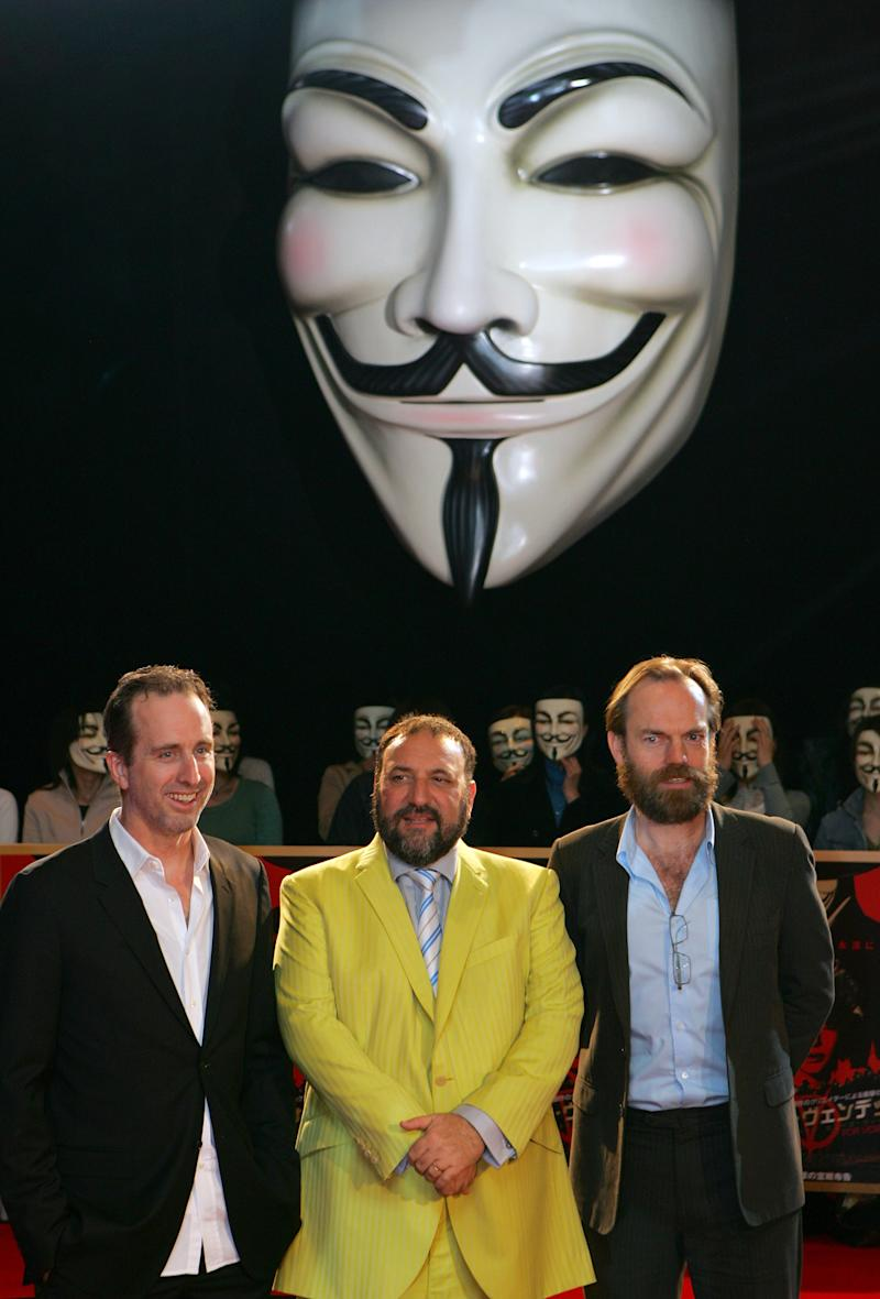 "FILE -In this April 17, 2006 photo, ""V for Vendetta"" director James McTeigue, left, producer Joel Silver, center, and actor Hugo Weaving pose for photographers as they are greeted by Japanese fans, all wearing masks from the movie, upon their arrival at the Japan premiere of their latest film in Tokyo. From demanding changes in plot lines that denigrate the Chinese leadership, to dampening lurid depictions of sex and violence, Beijing is having increasing success in pressuring Hollywood into deleting movie content Beijing finds objectionable. However, last year's showing on Chinese television of the 2005 political adventure ""V for Vendetta"" was seen as a notable step forward - it remains beholding to sensitivities that makes its decisions sometimes hard to fathom. (AP Photo/Shizuo Kambayashi, File)"