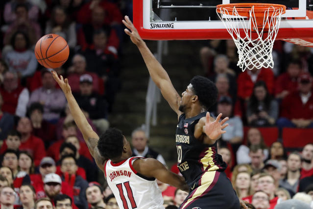 Florida State's Malik Osborne (10) goes up to block the shot of North Carolina State's Markell Johnson (11) during the second half of an NCAA college basketball game in Raleigh, N.C., Saturday, Feb. 22, 2020. (AP Photo/Karl B DeBlaker)