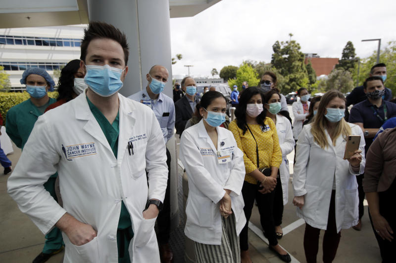 FILE - In this April 17, 2020, file photo, hospital personnel stand outside Providence St. John's Medical Center in Santa Monica, Calif. California hit more than 1,000 deaths linked to the coronavirus on Friday, April 17, 2020, according to a tally by Johns Hopkins University. (AP Photo/Marcio Jose Sanchez, File)