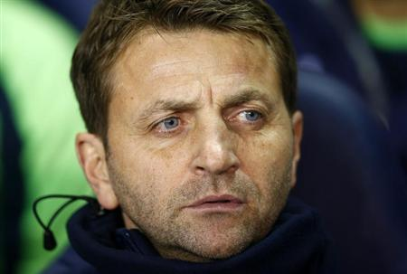 Tottenham Hotspur caretaker manager Tim Sherwood watches their English League Cup soccer match against West Ham United at White Hart Lane, London, December 18, 2013. REUTERS/Andrew Winning