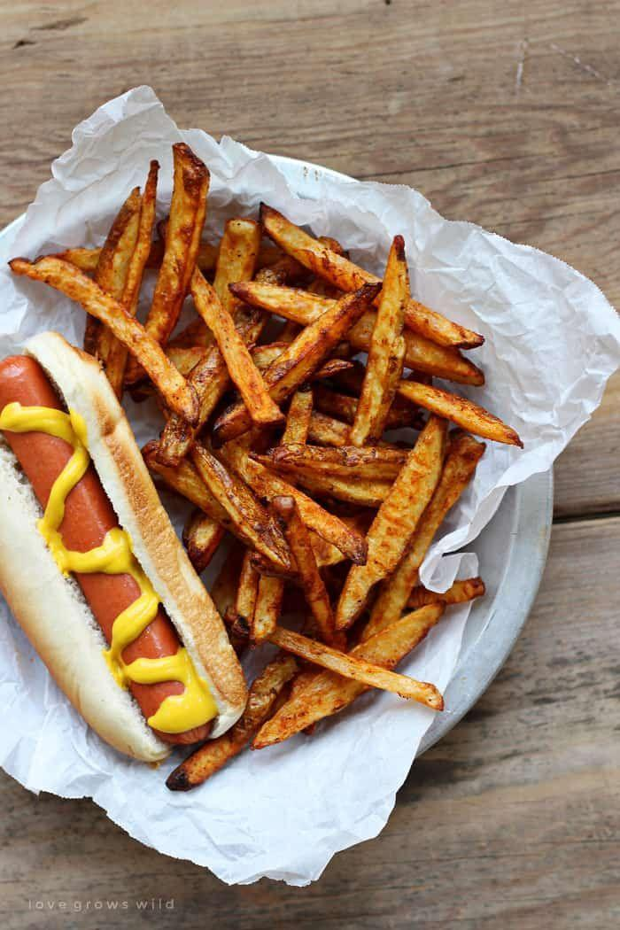 """<p>Is there any better accompaniment to burgers and hot dogs than crispy French fries—especially with a host of dipping sauces?</p><p><a href=""""https://www.fivehearthome.com/baked-seasoned-french-fries/"""" rel=""""nofollow noopener"""" target=""""_blank"""" data-ylk=""""slk:Get the recipe."""" class=""""link rapid-noclick-resp"""">Get the recipe. </a></p>"""
