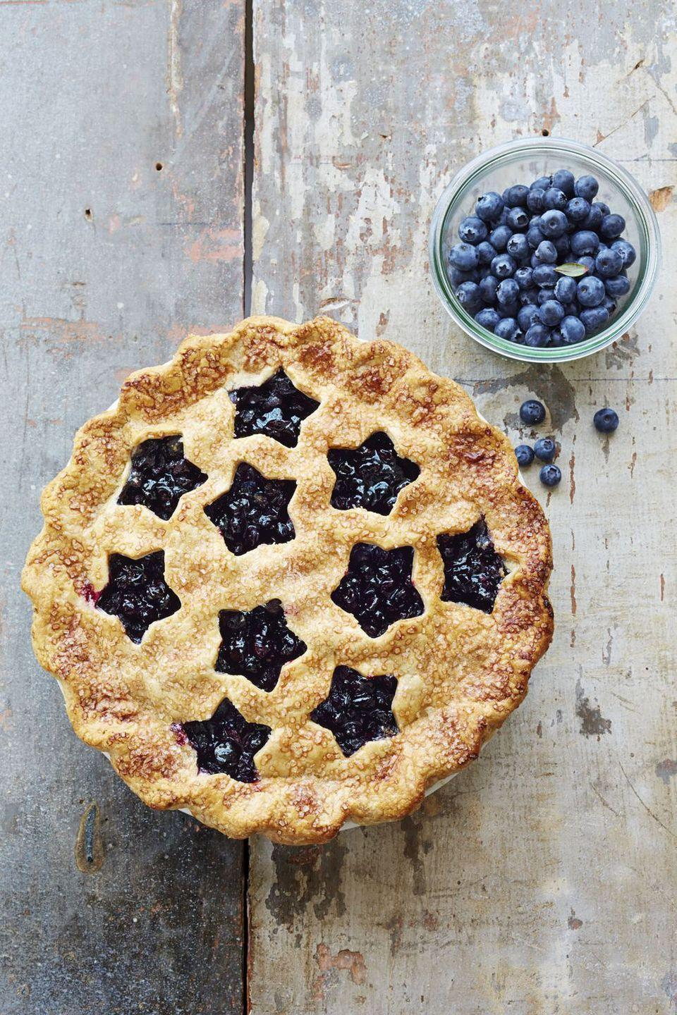 """<p>Turn a basic blueberry pie into a star-studded dessert — literally — with the help of patriotic cookie cutters.</p><p><em><a href=""""https://www.goodhousekeeping.com/food-recipes/dessert/g1328/fruit-pies/?slide=2"""" rel=""""nofollow noopener"""" target=""""_blank"""" data-ylk=""""slk:Get the recipe for Cutaway Blueberry Pie »"""" class=""""link rapid-noclick-resp"""">Get the recipe for Cutaway Blueberry Pie »</a></em></p>"""