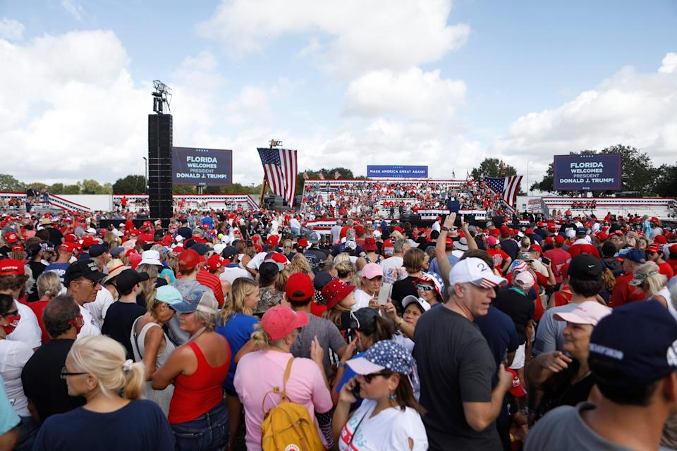 Supporters of President Donald Trump, some who are not wearing face coverings, arrive to hear his campaign speech on Thursday in Tampa, Florida.
