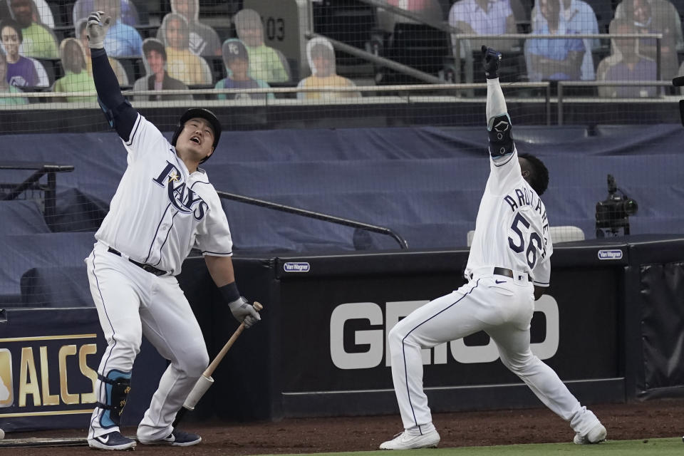 Tampa Bay Rays Randy Arozarena (56) celebrates his two run home run against the Houston Astros with Ji-Man Choi during the first inning in Game 7 of a baseball American League Championship Series, Saturday, Oct. 17, 2020, in San Diego. (AP Photo/Jae C. Hong)