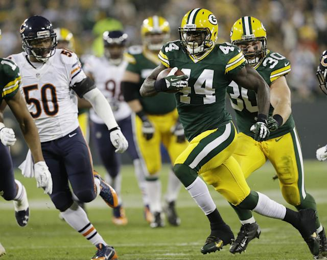 Green Bay Packers' James Starks (44) breaks away for a 32-yard touchdown run during the first half of an NFL football game against the Chicago Bears Monday, Nov. 4, 2013, in Green Bay, Wis. (AP Photo/Mike Roemer)