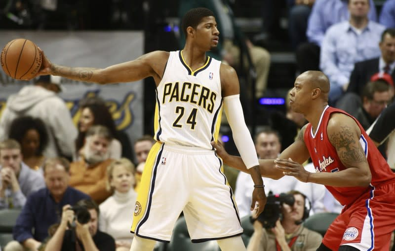 Indiana Pacers' George holds the basketball away from Los Angeles Clippers' Butler during the first half of their NBA basketball game in Indianapolis, Indiana