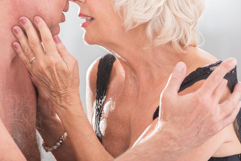 Cropped picture of an elderly couple kissing passionately