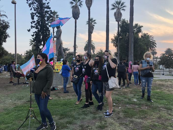 People gather in MacArthur Park on Monday evening to honor Daniela Hernandez, a transgender woman who was attacked Sunday.