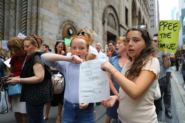 <p>Charlotte and Amelia of Brooklyn hold a sign during n a rally protesting President Trump'€™s immigration policy iof separating immigrant families in New York City on June 20, 2018. (Photo: Gordon Donovan/Yahoo News) </p>
