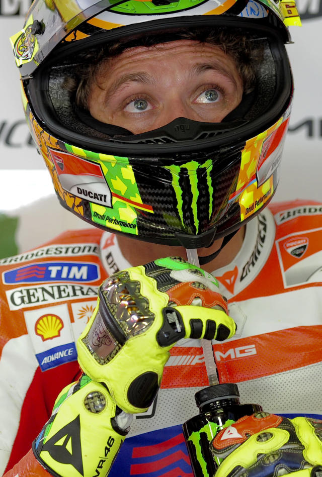 Ducati Team's Italian Valentino Rossi drinks in his pits at the Catalunya racetrack in Montmelo, near Barcelona, on June 2, 2012, during the MotoGP third training session of the Catalunya Moto GP Grand Prix. AFP PHOTO / JOSEP LAGOJOSEP LAGO/AFP/GettyImages