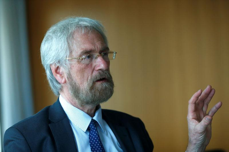 FILE PHOTO: European Central Bank (ECB) executive board member Praet speaks during an interview with Reuters in Frankfurt