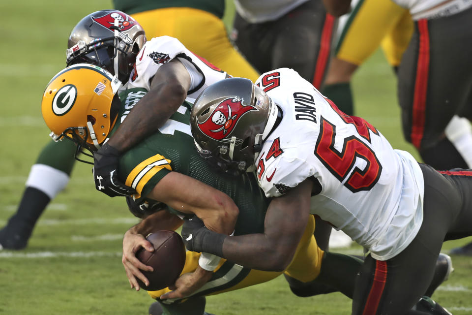 Tampa Bay Buccaneers inside linebacker Lavonte David (54) and outside linebacker Jason Pierre-Paul (90) team up to sack Green Bay Packers quarterback Aaron Rodgers (12) during the second half of an NFL football game Sunday, Oct. 18, 2020, in Tampa, Fla. (AP Photo/Mark LoMoglio)