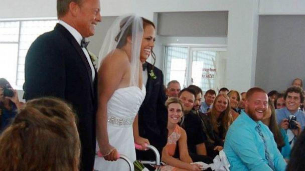 Stevie Beale, of Toledo, Ohio, walked down the aisle Saturday seven years after she was paralyzed from the waist down in a car crash.
