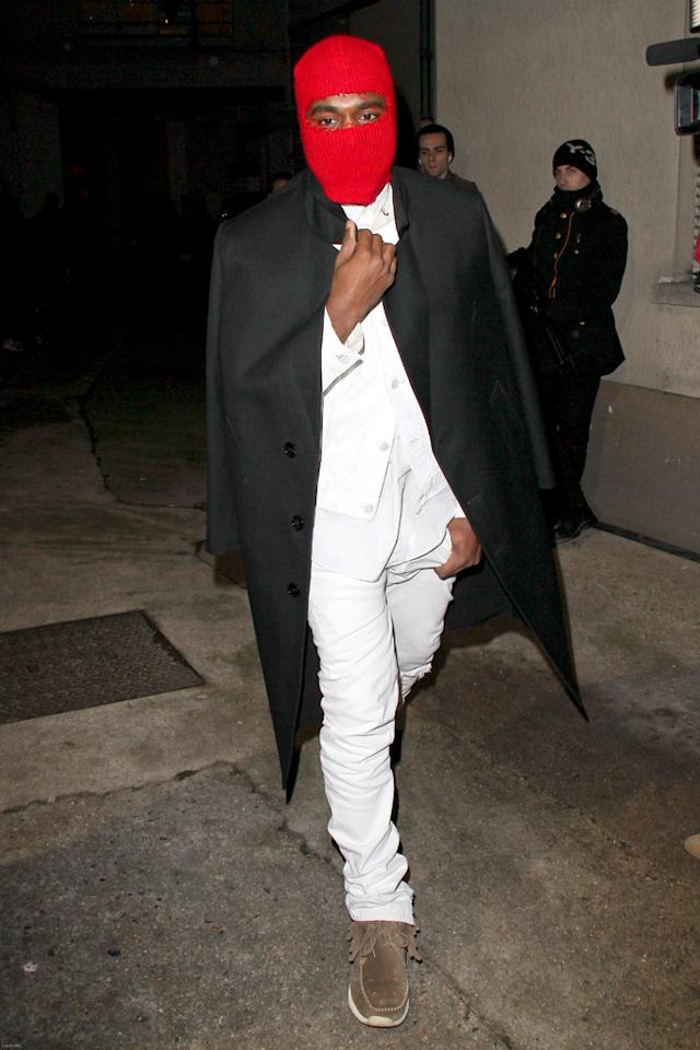 Kanye West attends the Maison Martin Margiela Spring/Summer 2013 Haute-Couture show as part of Paris Fashion Week.
