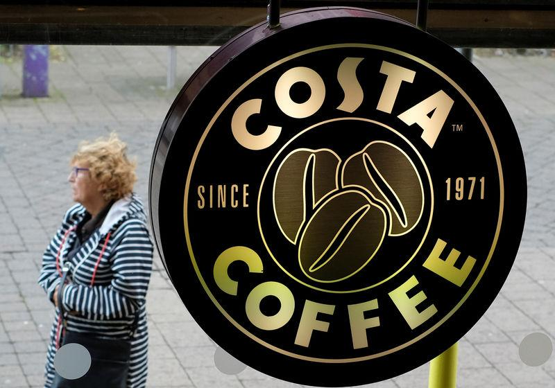 A woman walks past a Costa Coffee in Loughborough
