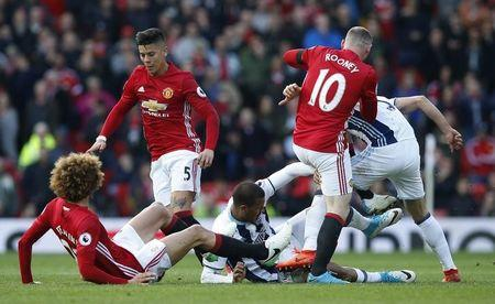West Bromwich Albion's Salomon Rondon in action with Manchester United's Marcos Rojo, Marouane Fellaini and Wayne Rooney