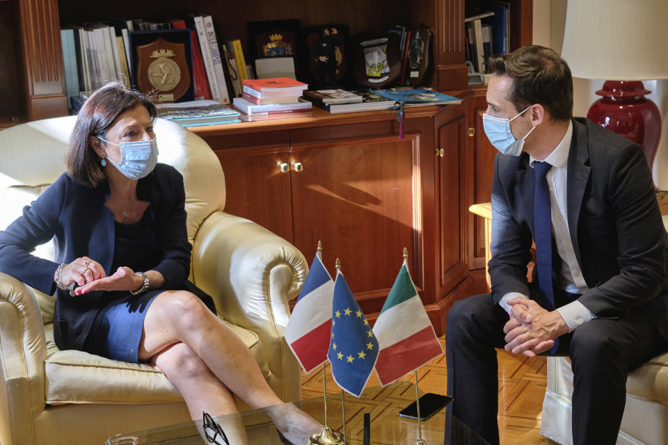 Italian Minister for Transports, Paolo De Micheli, left, meets her French counterpart, Jean-Baptiste Djebbari, in Rome, Monday, June 15, 2020. France Minister for Transport Jean-Baptiste Djebbari arrived in Italy on the day France reopened the frontier with Italy and other major European countries. Many European countries are reopening borders to each other after three months of coronavirus closures, restoring freedom of movement that was interrupted abruptly in March. But some restrictions persist, and it's unclear how keen Europeans will be to travel this summer. (Mauro Scrobogna/LaPresse via AP)