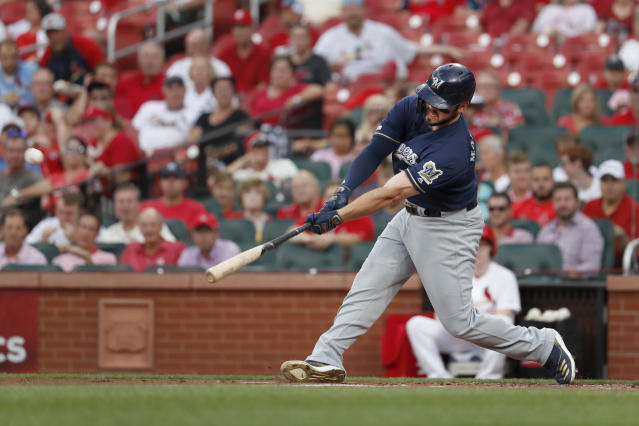 Milwaukee Brewers' Mike Moustakas hits a three-run home run during the first inning of a baseball game against the St. Louis Cardinals Wednesday, Aug. 21, 2019, in St. Louis. (AP Photo/Jeff Roberson)