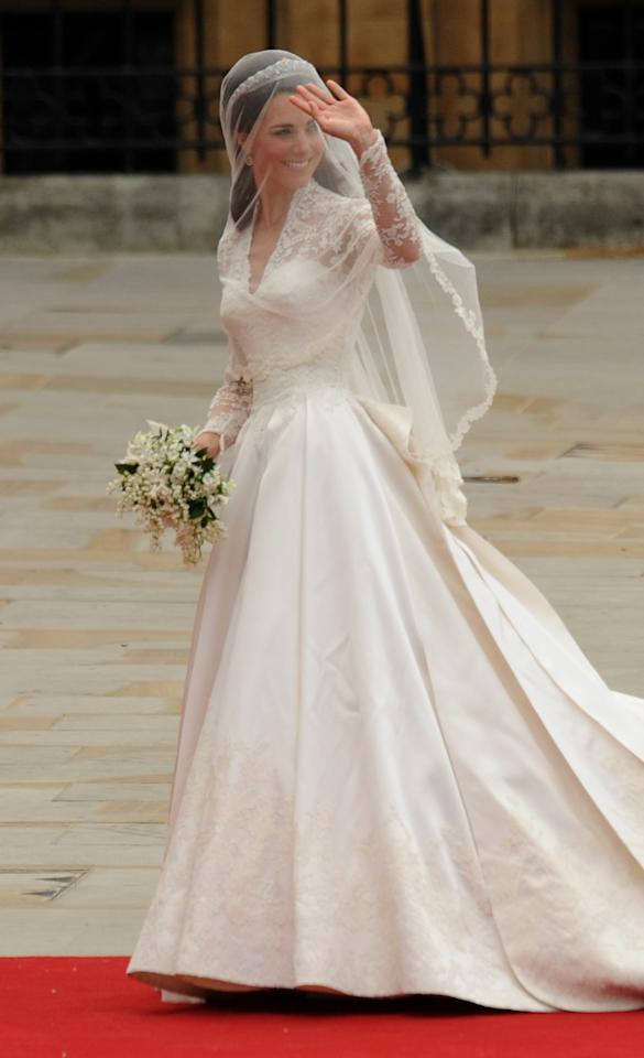 <p>Kate's delicate, and demure, lace dress was designed by Sarah Burton for Alexander McQueen. <em>[Photo: PA]</em> </p>