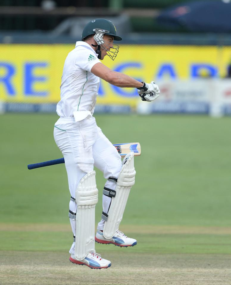 JOHANNESBURG, SOUTH AFRICA - DECEMBER 22: Faf du Plessis of South Africa celebrates his 100 during day 5 of the 1st Test match between South Africa and India at Bidvest Wanderers Stadium on December 22, 2013 in Johannesburg, South Africa. (Photo by Duif du Toit/Gallo Images)