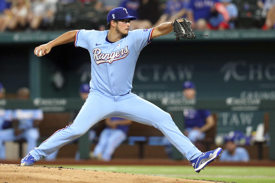Texas Rangers starting pitcher Dane Dunning delivers in the third inning against the Minnesota Twins in a baseball game Sunday, June 20, 2021, in Arlington, Texas. (AP Photo/Richard W. Rodriguez)