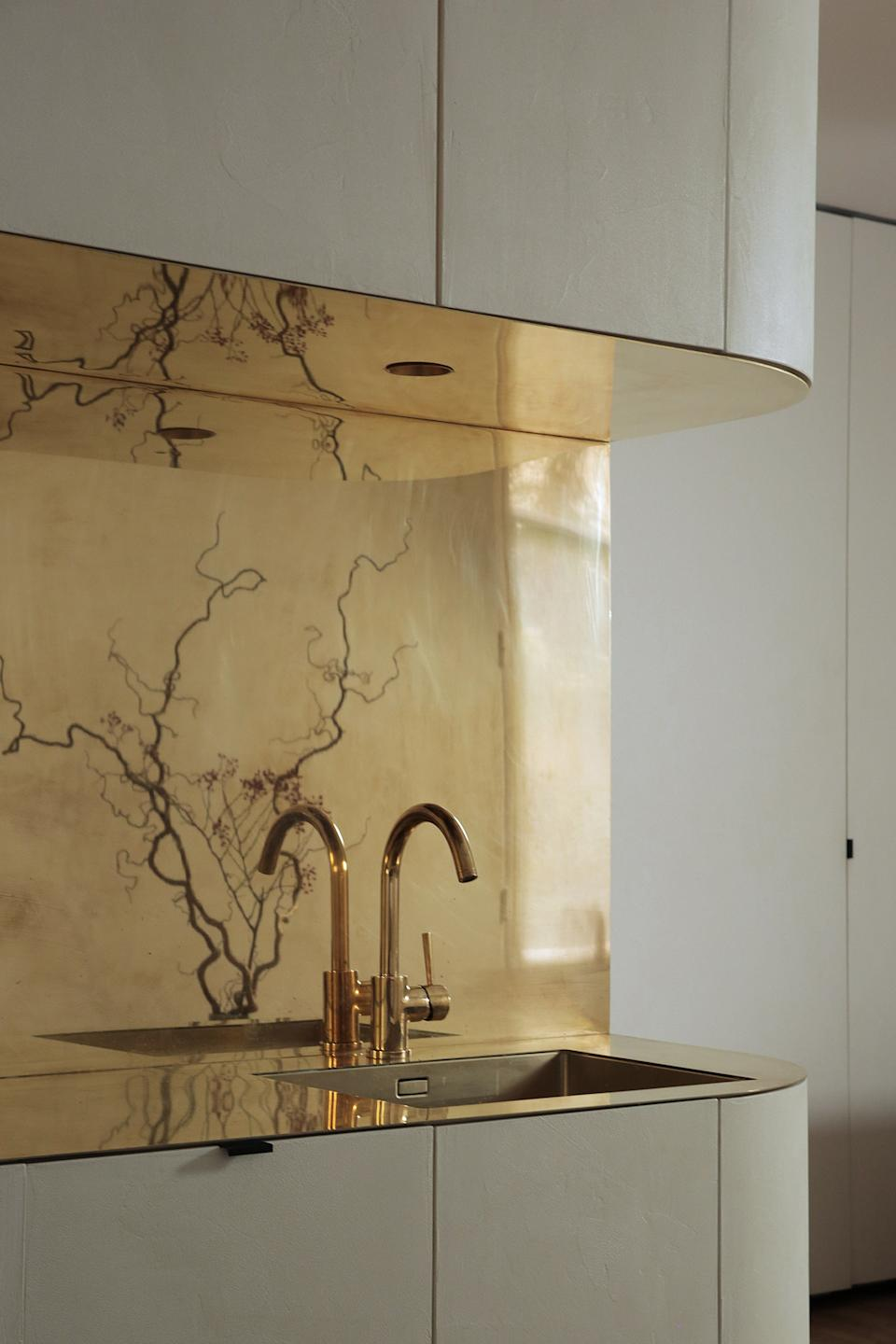 """<div class=""""caption""""> The custom cabinetry curves around the corner to allow for even more storage space. </div>"""