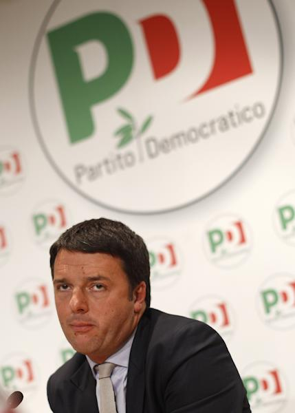 Newly elected PD, Democratic Party secretary general Matteo Renzi attends a press conference he held at Rome's party headquarters, Monday, Dec. 9, 2013. Italy's new leader of the Democratic Party, the government's biggest coalition partner, is pledging to back Premier Enrico Letta. Florence Mayor Matteo Renzi met with Letta in Rome Monday, a day after being elected the center-left party's No. 1 leader in a primary. Renzi has made no secret of his ambitions to become premier. His election as party's secretary Sunday raised some concern he might make Letta's tenure at the helm of government difficult. (AP Photo/Andrew Medichini)