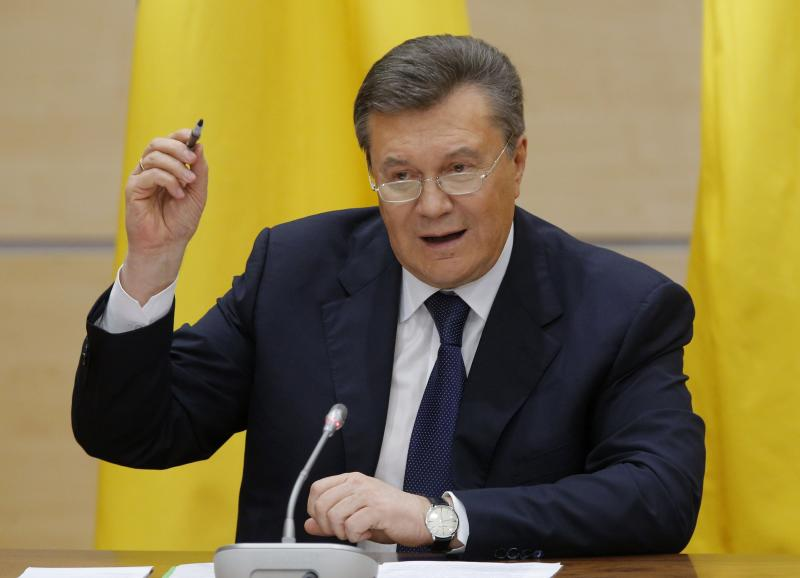 Ousted Ukrainian President Viktor Yanukovich takes part in a news conference in the southern Russian city of Rostov-on-Don February 28, 2014. Yanukovich, appearing in public for the first time since he was ousted as Ukraine's president, said in Russia on Friday he would not give up the fight for his country's future. REUTERS/Maxim Shemetov (RUSSIA - Tags: POLITICS)