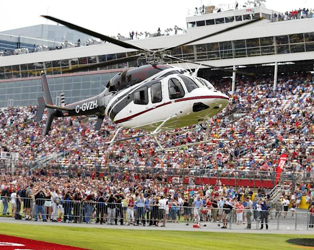 Driver Kurt Busch arrives via helicopter from Indianapolis before the NASCAR Sprint Cup series Coca-Cola 600 auto race at Charlotte Motor Speedway in Concord, N.C., Sunday, May 25, 2014. Busch finished sixth in the Indianapolis 500 earlier in the day. (AP Photo/Chris Keane)