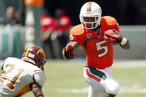 Miami running back Mike James (5) runs against Bethune-Cookman defensive back Tim Burke (21) in the first half of an NCAA college football game, Saturday Sept. 15, 2012, in Miami. (AP Photo/Wilfredo Lee)