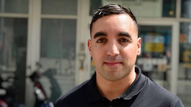 Ramdhane Belhabchia, 32, who is French of Algerian origin, is one of three people alleging discriminatory treatment by the same manager at an Éconofitnessgym in Montreal. The Quebec-based company says it has launched an internal investigation.  (Jean-Claude Taliana/CBC - image credit)