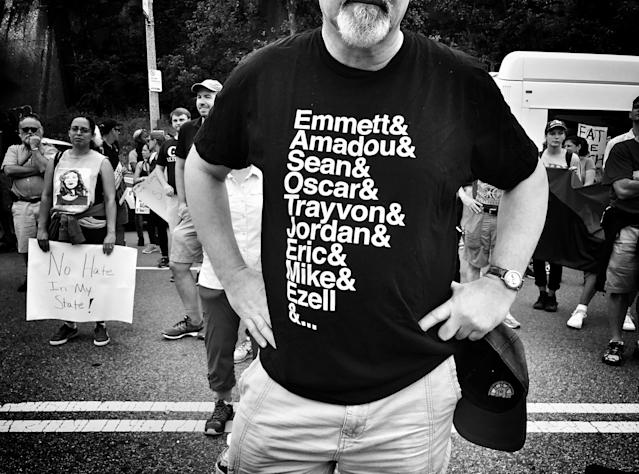 "<p>A man wears a shirt depicting African-Americans killed by police or other violence during a counterprotest against a ""free speech"" rally staged by conservative activists Aug. 19 in Boston. (Photo: Holly Bailey/Yahoo News) </p>"