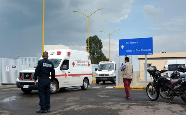 <p>Ambulances are seen at the airport of Durango, in northern Mexico, after a plane carrying 97 passengers and four crew crashed during take off on July 31, 2018. (Photo: Lulu Murillo/AFP/Getty Images) </p>
