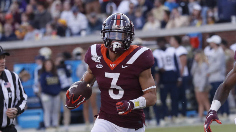 Virginia Tech defensive back Caleb Farley (3) returns an interception for a touchdown in the first half of an NCAA football game against Georgia Tech Saturday, Nov. 16, 2019, in Atlanta. (AP Photo/John Bazemore)