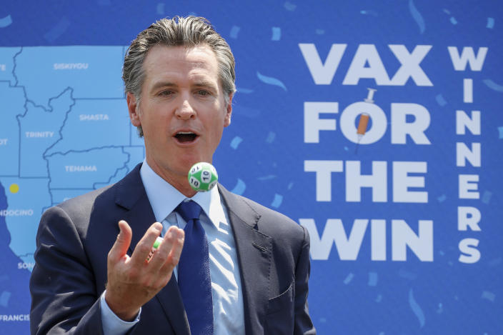 Universal City, CA - June 15: As part of California's full reopening, marking the end of pandemic-era restrictions like masks, social distancing and most capacity restrictions, Gov. Gavin Newsom juggles numbered balls following the conclusion of a press conference at Universal Studios, in Universal City, CA, Tuesday, June 15, 2021. Governor Newsom drew 10 winners to receive $1.5 million each, for a total of $15 million, as part of the final cash prize drawing in the state's $116.5 million Vax for the Win program - the largest vaccine incentive program in the nation. (Jay L. Clendenin / Los Angeles Times via Getty Images)