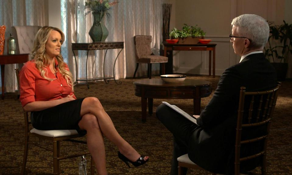 <em>Stormy Daniels claims she was threatened to keep quiet about her alleged affair with Donald Trump (AP)</em>