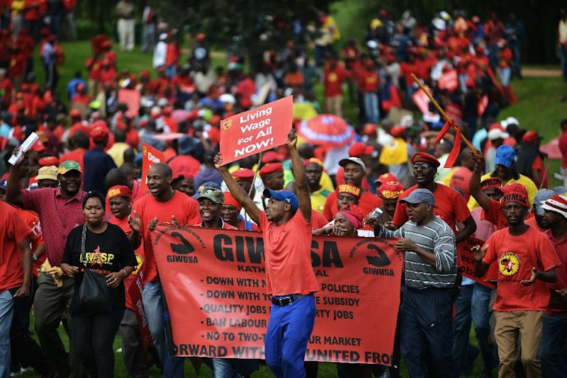 Striking members of NUMSA (National Union of Metal Workers of South Africa) demonstrate for better wages in a central district of Johannesburg on March 19, 2014