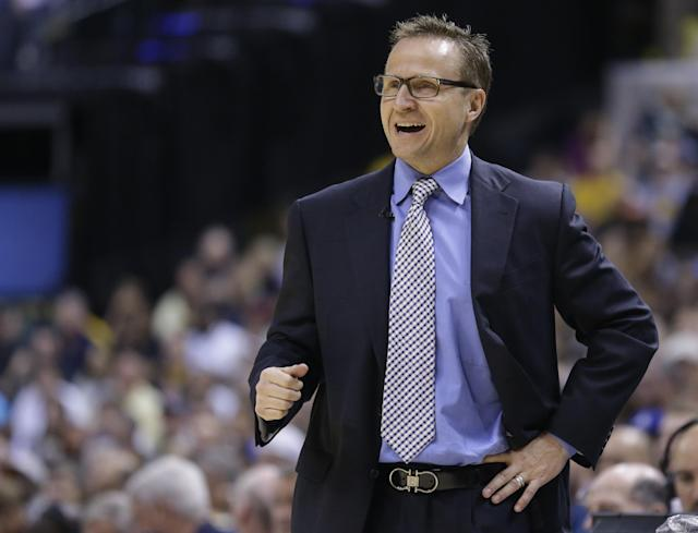 Oklahoma City Thunder head coach Scott Brooks yells to his team as they play against the Indiana Pacers in the second half of an NBA basketball game in Indianapolis, Sunday, April 13, 2014. The Pacers defeated the Thunder 102-97. (AP Photo/Michael Conroy)