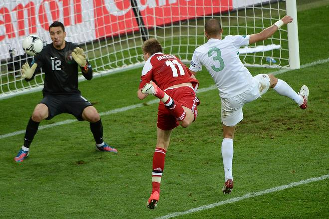 TOPSHOTS Danish forward Nicklas Bendtner (C) scores during the Euro 2012 championships football match Denmark vs Portugal on June 13, 2012 at the Arena Lviv.                AFP PHOTO / ANNE-CHRISTINE POUJOULATANNE-CHRISTINE POUJOULAT/AFP/GettyImages