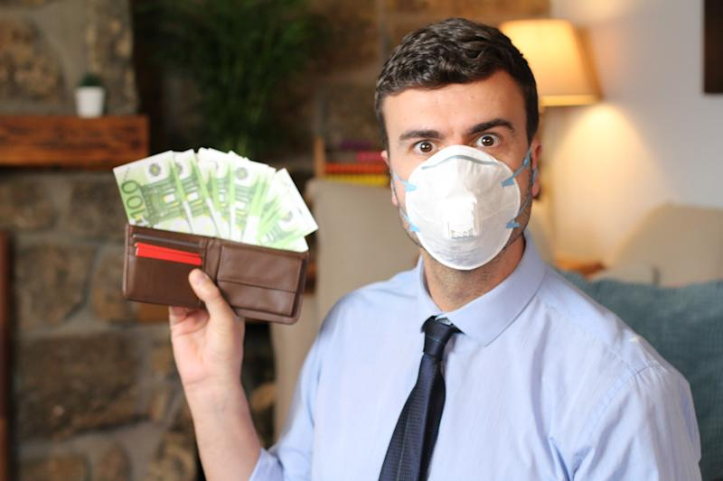 Businessman showing full wallet during viral outbreak recession.
