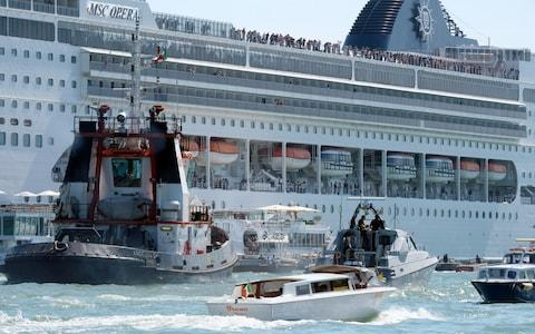 A cruise ship lost control and crashed against a smaller tourist boat at the San Basilio dock in Venice - Credit: REUTERS/Manuel Silvestri