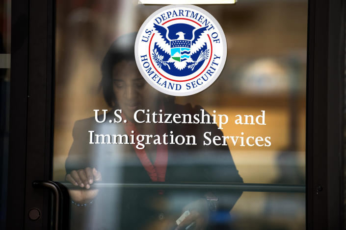 A woman leaves the U.S. Citizenship and Immigration Services offices in New York, August 15, 2012. (PHOTO: REUTERS/Keith Bedford)