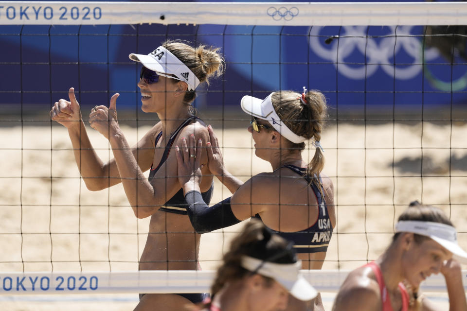 April Ross, right, of the United States, and teammate Alix Klineman celebrate winning a women's beach volleyball semifinal match against Switzerland at the 2020 Summer Olympics, Thursday, Aug. 5, 2021, in Tokyo, Japan. (AP Photo/Petros Giannakouris)