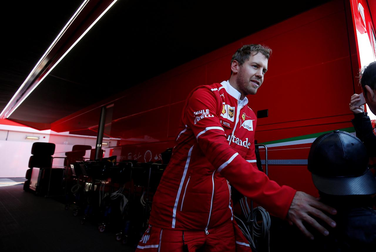 Formula One - F1 - Test session - Barcelona - Catalunya racetrack in Montmelo, Spain - 27/2/17. Ferrari's Sebastian Vettel walks by the paddock. REUTERS/Albert Gea