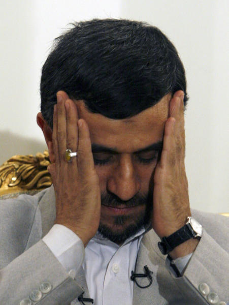 FILE-In this Monday, March 3, 2008, file photo, Iranian President Mahmoud Ahmadinejad, touches his face as he prepares for a news brief while he arrives at the Mehrabad airport in Tehran, Iran, after his two-day visit to Iraq. No one is really counting on outgoing President Mahmoud Ahmadinejad to fade away once the spotlight-hungry politician formally hands over the office in three weeks. What's ahead remains a murky mix of expected payback from his opponents and speculation on his next moves, ranging from media boss to freelance statesman. (AP Photo/Vahid Salemi, File)