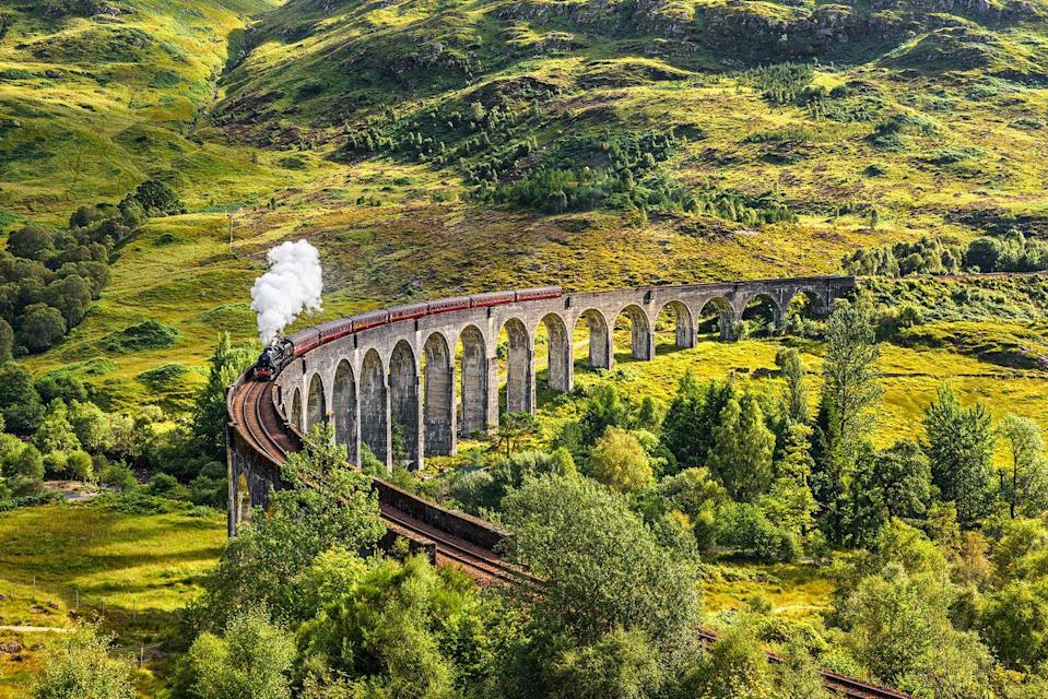 """<p>For remote, wild beauty in Britain, look no further than the breathtaking Scottish Highlands. We can't wait to take in the fresh air and magic of this UK spot. There's no better way to do it than by catching the Jacobite steam train, Harry Potter style! This real-life Hogwarts Express featured in the films and is a bucket list experience everyone should try at least once.</p><p>Good Housekeeping's four-day Scotland by steam tour is an excellent way to see the Highlands, cruise on Loch Katrine and check out the Falkirk Wheel, with departures in summer 2021.</p><p><a class=""""link rapid-noclick-resp"""" href=""""https://www.goodhousekeepingholidays.com/tours/scotland-highlands-steam-train-jacobite"""" rel=""""nofollow noopener"""" target=""""_blank"""" data-ylk=""""slk:FIND OUT MORE"""">FIND OUT MORE</a></p><p><strong>We want to help you plan your next getaway with the experts. Sign up for the latest travel tales and to hear about our favourite financially protected escapes and bucket list adventures. </strong></p><p><a class=""""link rapid-noclick-resp"""" href=""""https://hearst.emsecure.net/optiext/optiextension.dll?ID=Mf2Mbm2t6kFIB2qaqu7QV5QAIooPPMrcO%2BU6d2SmsL4zpSgeyQIbzx5P9sbmxMKLhPooFIrsXaC2MY"""" rel=""""nofollow noopener"""" target=""""_blank"""" data-ylk=""""slk:SIGN UP"""">SIGN UP</a></p>"""