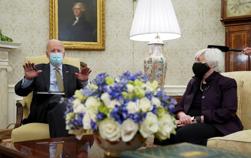 FILE PHOTO: U.S. President Biden receives the weekly economic briefing at White House event in Washington